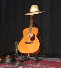 [Jack's guitar and hat]